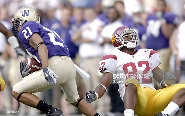 Trojans Chris McFoy reacts to a cut by Huskies Sonny Shackelford that caused McFoy to miss tackling him during the game between the USC Trojans and...