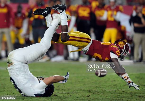 Trojans cornerback Ajene Harris knocks a pass away from Arizona Wildcats tight end Trevor Wood in the third quarter of a game played on November 4...