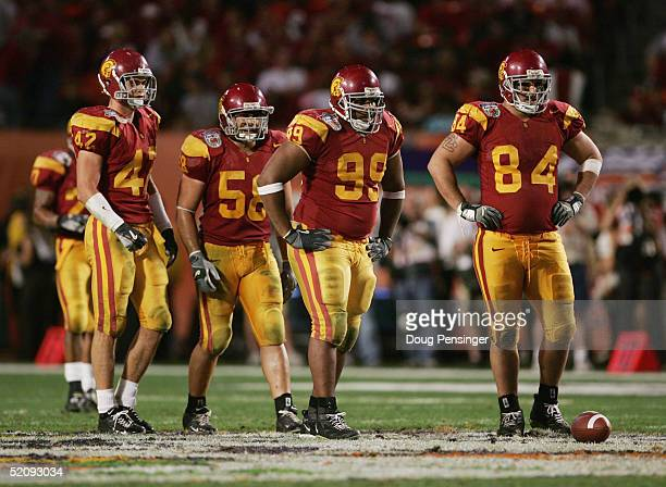 Trojans Dallas Sartz Lofa Tatupu Mike Patterson and Shaun Cody look on against the Oklahoma Sooners in the 2005 FedEx Orange Bowl National...