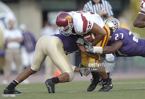 Trojans David Kirtman is stopped by the Huskies defense during the game between the USC Trojans and the University of Washington Huskies at Husky...