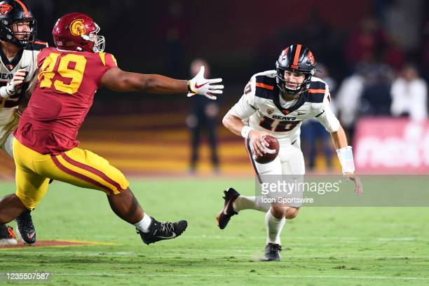 Trojans defensive lineman Tuli Tuipulotu tries to tackle Oregon State Beavers quarterback Chance Nolan during a college football game between the...