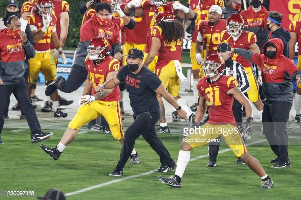 Trojans excited after fourth down stop during USC Trojans vs UCLA Bruins football game on December 12, 2020 at the Rose Bowl in Pasadena, CA.
