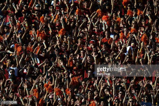 Trojans fans celebrate a touchdown against the Hawaii Warriors at Los Angeles Coliseum on September 1 2012 in Los Angeles California