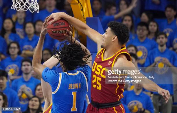 Trojans forward Bennie Boatwright blocks a shot on UCLA Bruins center Moses Brown at Pauley Pavilion in Los Angeles on Thursday Feb 28 2019