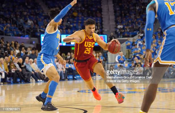 Trojans forward Bennie Boatwright drives to the basket around UCLA Bruins guard Jules Bernard at Pauley Pavilion in Los Angeles on Thursday Feb 28...