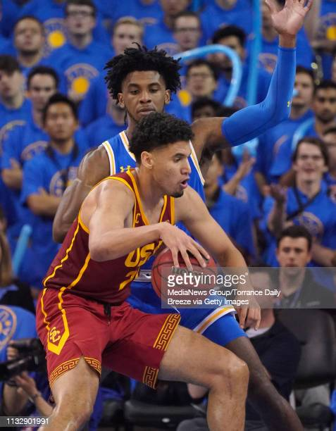 Trojans forward Bennie Boatwright looks for a way around UCLA Bruins guard Jalen Hill at Pauley Pavilion in Los Angeles on Thursday Feb 28 2019 UCLA...