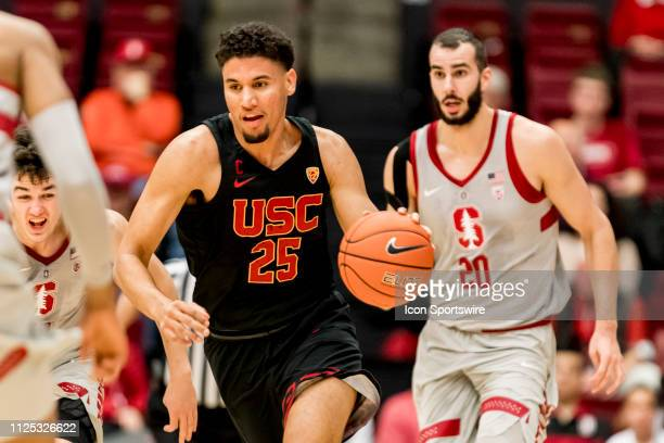 Trojans forward Bennie Boatwright threads the needle during the men's college basketball game between the USC Trojans and Stanford Cardinal on...