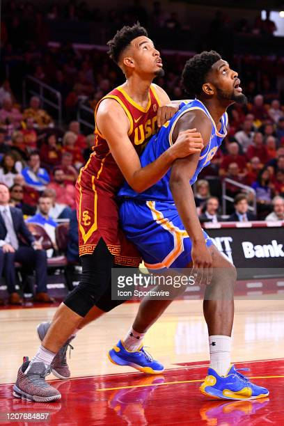 Trojans forward Isaiah Mobley and USC Trojans guard Jonah Mathews battle inside during the college basketball game between the UCLA Bruins and the...