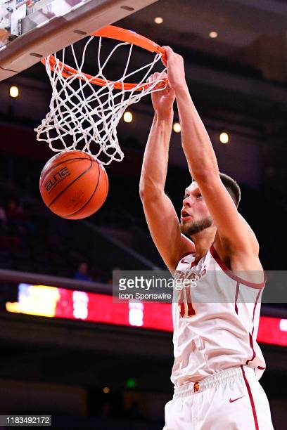Trojans forward Nick Rakocevic dunks the ball during a college basketball game between the Pepperdine Waves and the USC Trojans on November 19, 2019...