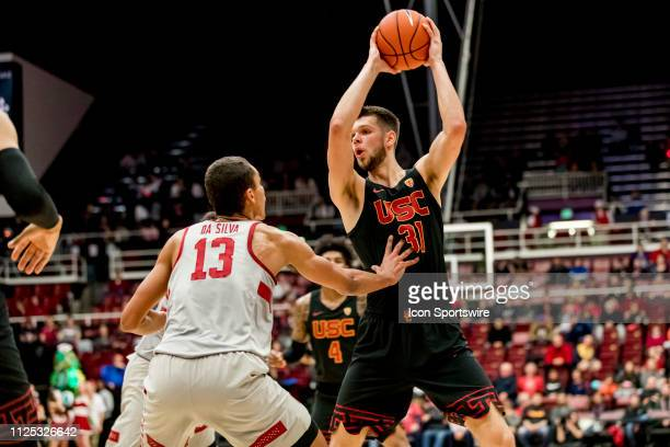 Trojans forward Nick Rakocevic looks for a pass during the men's college basketball game between the USC Trojans and Stanford Cardinal on February 13...