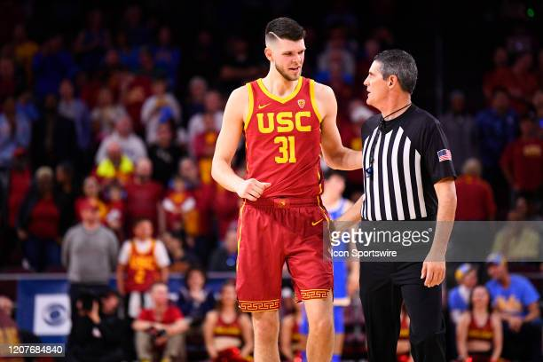 Trojans forward Nick Rakocevic talks with an official during the college basketball game between the UCLA Bruins and the USC Trojans on March 7 2020...