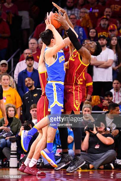 Trojans forward Onyeka Okongwu blocks UCLA Bruins forward Jaime Jaquez Jr shot during the college basketball game between the UCLA Bruins and the USC...