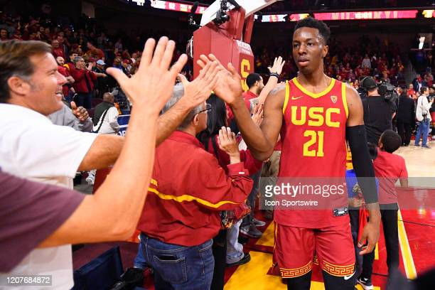 Trojans forward Onyeka Okongwu gives high fives after the college basketball game between the UCLA Bruins and the USC Trojans on March 7 2020 at...