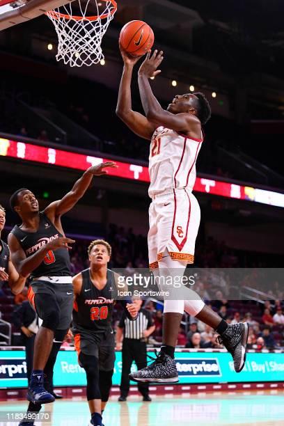Trojans forward Onyeka Okongwu scores inside during a college basketball game between the Pepperdine Waves and the USC Trojans on November 19, 2019...