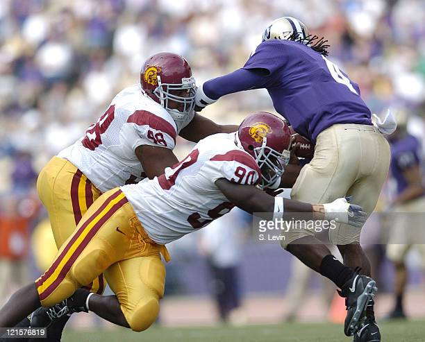 Trojans Frostee Rucker and LaJuan Ramsey sack Huskies quarterback Isaiah Stanback during the game between the USC Trojans and the University of...