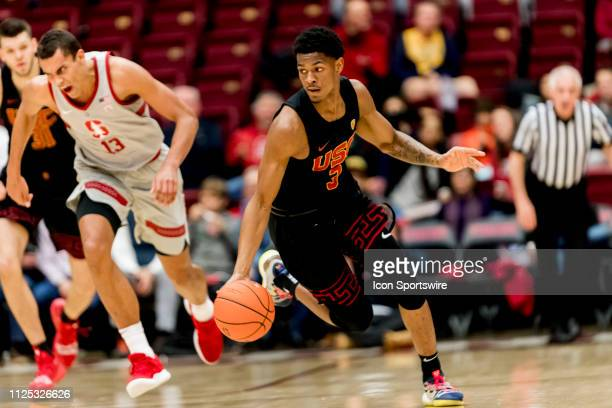 Trojans guard Elijah Weaver brings the ball down the court during the men's college basketball game between the USC Trojans and Stanford Cardinal on...