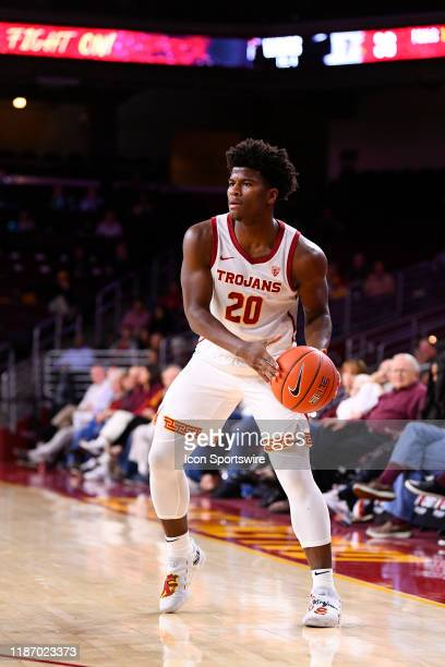 Trojans guard Ethan Anderson looks to make a pass during a college basketball game between the Pepperdine Waves and the USC Trojans on November 19,...