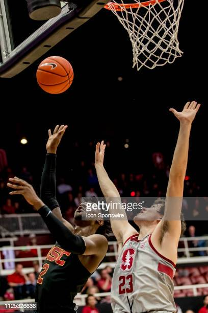 Trojans guard Jonah Mathews attempts a shot over Stanford Cardinal guard Cormac Ryan during the men's college basketball game between the USC Trojans...