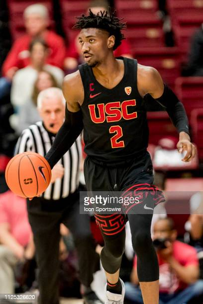 Trojans guard Jonah Mathews brings the ball down the court during the men's college basketball game between the USC Trojans and Stanford Cardinal on...
