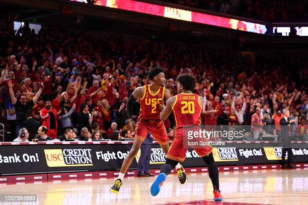 Trojans guard Jonah Mathews celebrates with USC Trojans guard Ethan Anderson after hitting the game winning shot during the college basketball game...