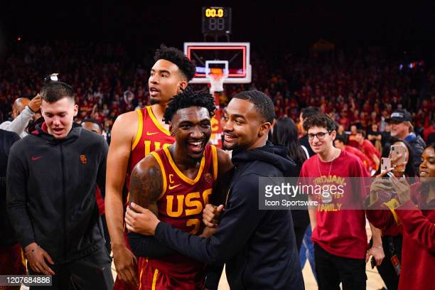 Trojans guard Jonah Mathews celebrates with USC Trojans guard Kyle Sturdivant after the college basketball game between the UCLA Bruins and the USC...