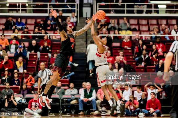 Trojans guard Kevin Porter Jr and Stanford Cardinal guard Marcus Sheffield fight for a ball in the air during the men's college basketball game...