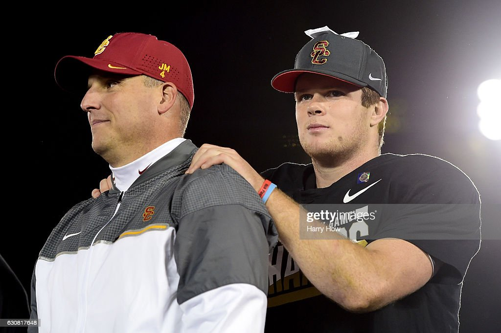 Trojans head coach Clay Helton and quarterback Sam Darnold #14 react after defeating the Penn State Nittany Lions 52-49 to win the 2017 Rose Bowl Game presented by Northwestern Mutual at the Rose Bowl on January 2, 2017 in Pasadena, California.