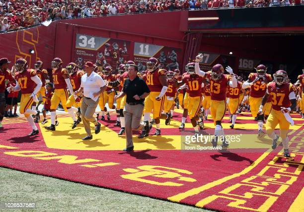 Trojans head coach Clay Helton Collin leads the team out on to the field during the game against the UNLV Rebels on September 01 at the Los Angeles...
