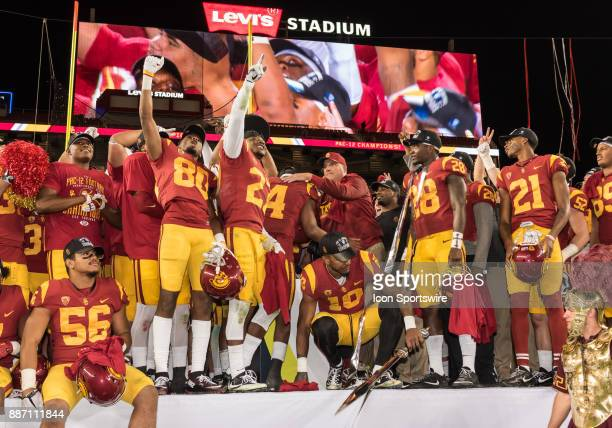 Trojans head coach Clay Helton congratulating his team following their win of the PAC12 Championship game between the USC Trojans and the Stanford...