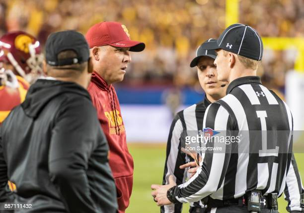 Trojans head coach Clay Helton discusses penalty options with Line Judge Dale Keller during the PAC12 Championship game between the USC Trojans and...