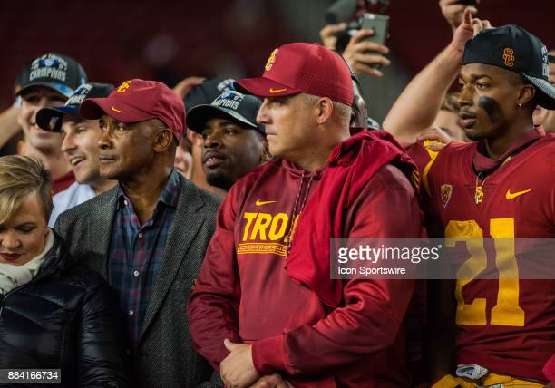 Trojans Head Coach Clay Helton enjoys his teams 3127 win after the Pac12 Championship game between the Stanford Cardinal and the USC Trojans on...