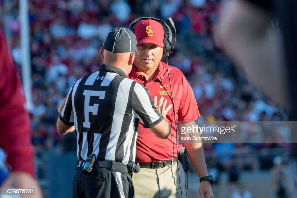 Trojans head coach Clay Helton gets an explanation from the referee during the football game between the Stanford Cardinal and USC Trojans on...