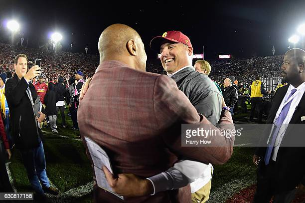Trojans head coach Clay Helton reacts with USC Trojans athletic director Lynn Swann after defeating the Penn State Nittany Lions 5249 to win the 2017...