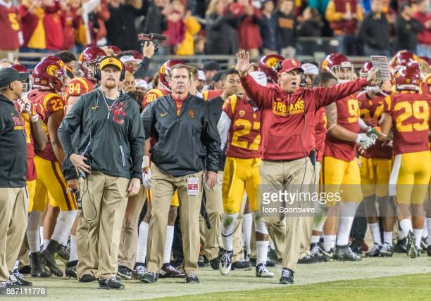 Trojans head coach Clay Helton signals to his team a play during the PAC12 Championship game between the USC Trojans and the Stanford Cardinals on...