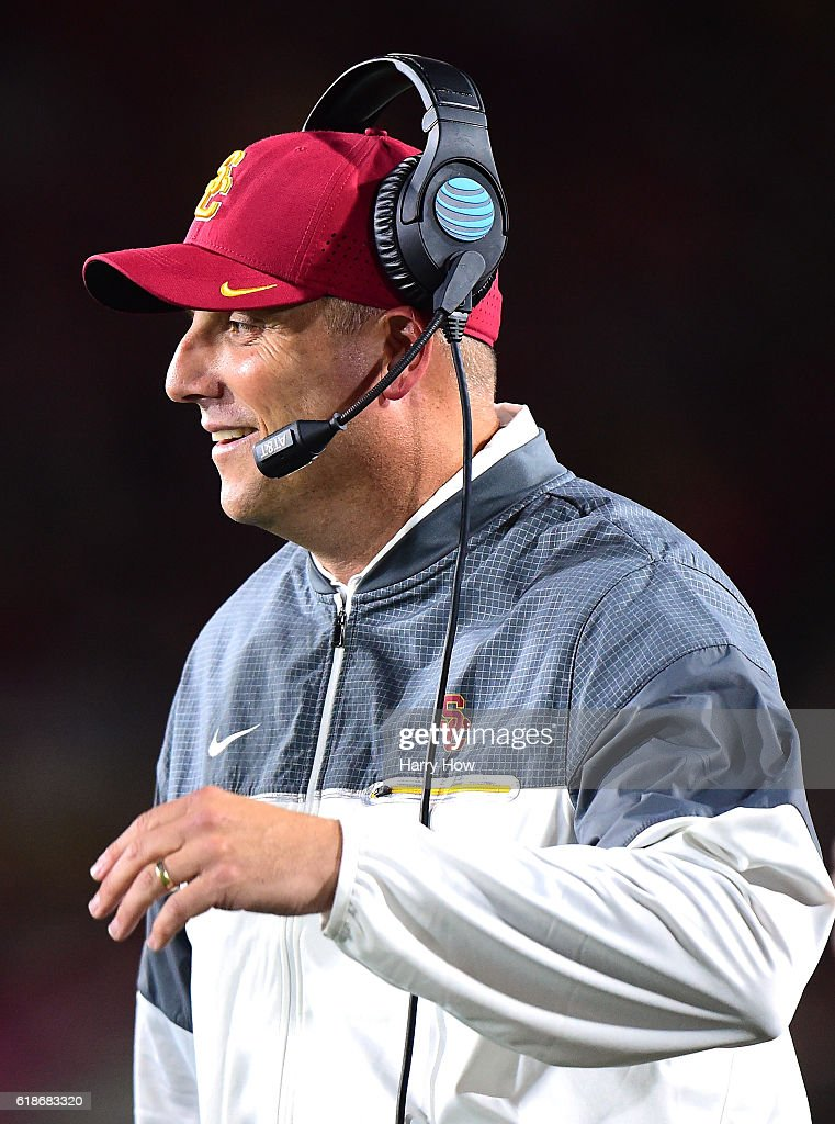 Trojans Head Coach Clay Helton smiles on the sidelines during the first quarter against the California Golden Bears at Los Angeles Coliseum on October 27, 2016 in Los Angeles, California.