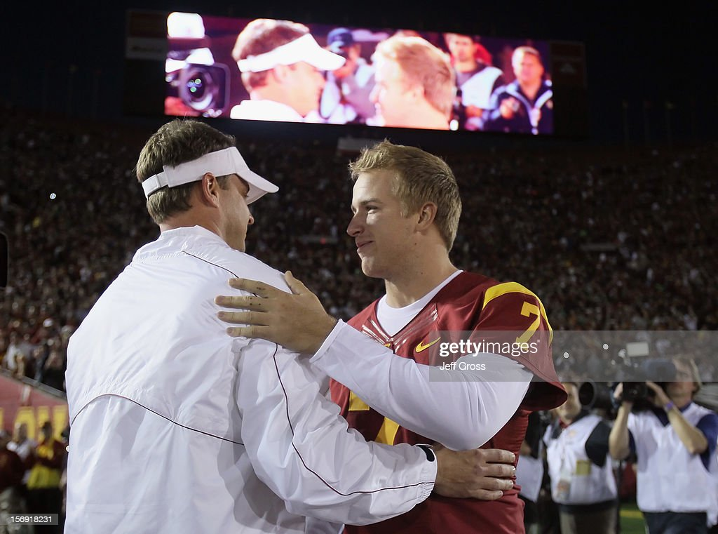 Trojans head coach Lane Kiffin greets senior quarterback Matt Barkley #7 prior to the start of the game against the Notre Dame Fighting Irish at Los Angeles Memorial Coliseum on November 24, 2012 in Los Angeles, California. Notre Dame defeated USC Trojans 22-13.