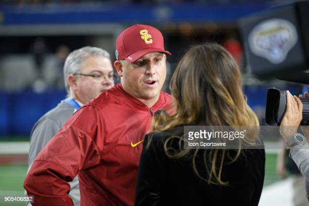 Trojans heat coach Clay Helton is interviewed during the Cotton Bowl Classic matchup between the USC Trojans and Ohio State Buckeyes on December 29...