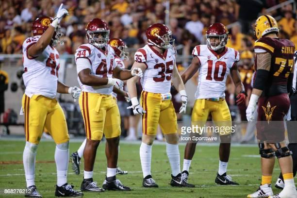 Trojans linebacker Cameron Smith , USC Trojans linebacker John Houston Jr. , USC Trojans defensive tackle Malik Dorton , and USC Trojans linebacker...