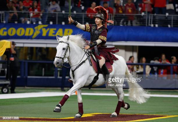 Trojans mascot Traveler gallops along the sideline before the 82nd Goodyear Cotton Bowl Classic between USC and Ohio State at ATT Stadium on December...
