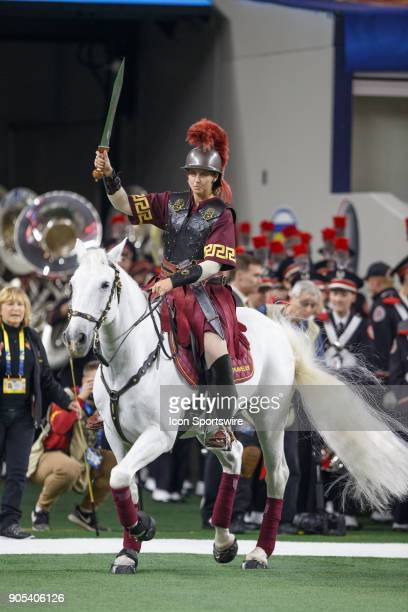 Trojans mascot Traveler IX runs onto the field during the Cotton Bowl Classic matchup between the USC Trojans and Ohio State Buckeyes on December 29...