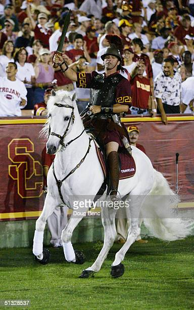 Trojans mascot Traveler the noble white horse appears with a regal Trojan warrior astride during the NCAA game between the University of Southern...