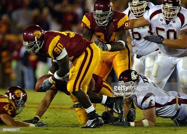 Trojans play the Washington State Cougars at the LA Coliseum USC defensive lineman Frostee Rucker recovers fumble as Washington State QB Matt Kegel...