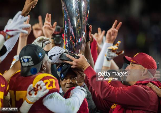 Trojans players and Head Coach Clay Helton lift up the conference trophy after winning 3127 in the Pac12 Championship game between the Stanford...