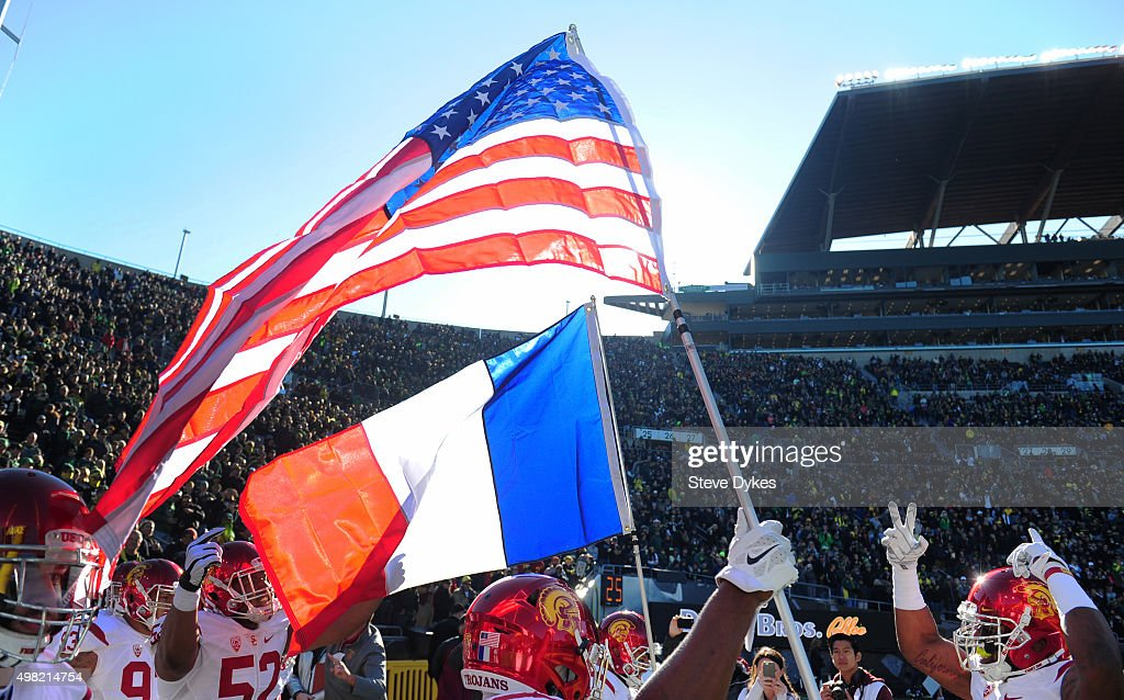 USC Trojans players carry out an American and a French flag in a show of support for the French people in the wake of the terror attack on November 13 in Paris before the game against the Oregon Ducks at Autzen Stadium on November 21, 2015 in Eugene, Oregon.