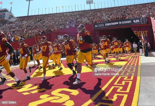 Trojans players run on to the the field for the game against the Oregon State Beavers at the Los Angeles Memorial Coliseum on October 7 2017 in Los...