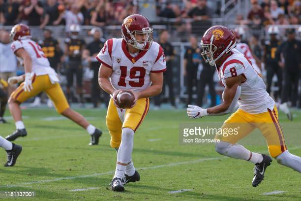 Trojans quarterback Matt Fink hands the ball off to USC Trojans wide receiver Amon-Ra St. Brown during the college football game between the USC...