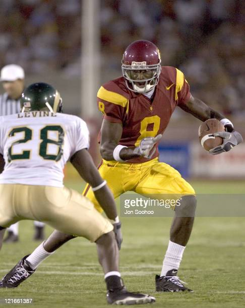 USC Trojans receiver Dwayne Jarrett runs with ball in the third quarter against the Colorado State Rams Saturday September 11 2004 at the Los Angeles...