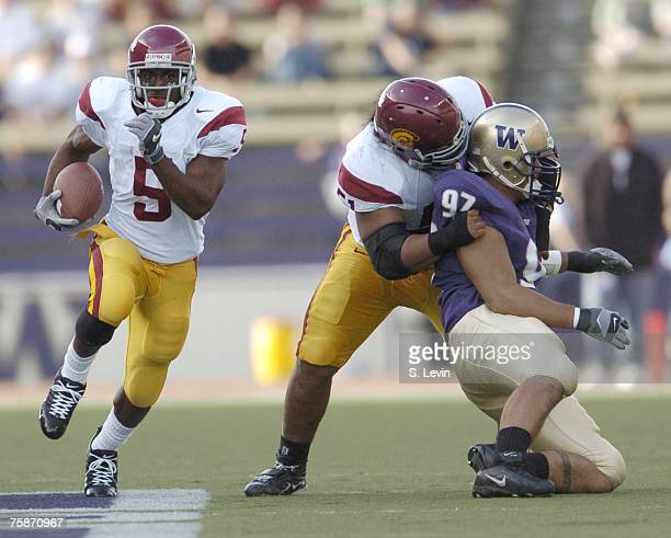 Trojans Reggie Bush finds a hole during the game between the USC Trojans and the University of Washington Huskies at Husky Stadium in Seattle WA on...
