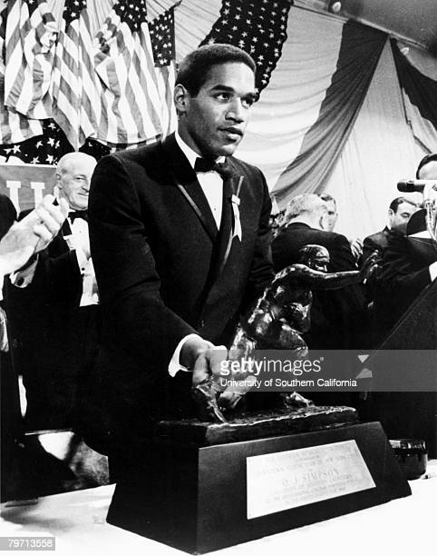 USC Trojans running back OJ Simpson accepts the Heisman Trophy on December 5 at the Downtown Athletic Club in Manhattan New York