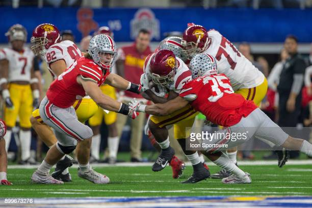 Trojans running back Ronald Jones II is tackled during the Goodyear Cotton Bowl Classic football game between the USC Trojans and the Ohio State...